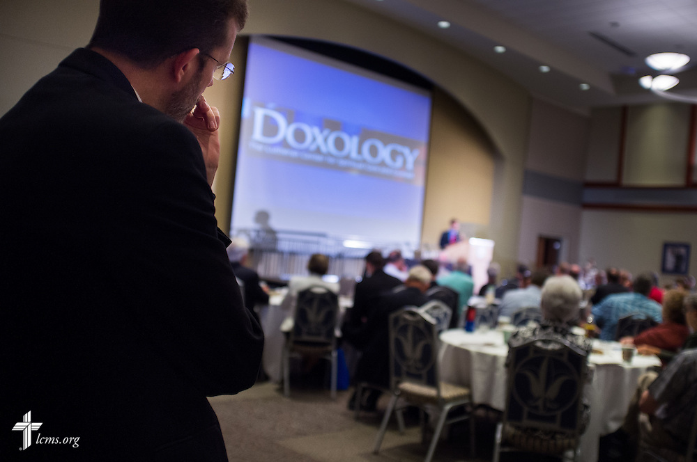 "The Rev. Randy Asburry, senior pastor of Hope Lutheran Church in St. Louis, listens as Sherif Girgis speaks during the DOXOLOGY event, ""Finding Our Voice,"" on Wednesday, August 12, 2015, at Saint Louis University in Midtown St. Louis. LCMS Communications/Erik M. Lunsford"