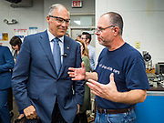 03 JUNE 2019 - ANKENY, IOWA: Governor JAY INSLEE, (D-WA), left, talks to MARK ROSENBERG, a faculty person in the tool and die class during a tour at DMACC Monday. Governor Inslee is running to be the Democratic candidate for the US Presidency in 2020, He has made climate change a central point of his campaign and he toured a wind turbine program at the Des Moines Area Community College (DMACC) in Ankeny. Iowa generates more than 35% of its electrical needs through wind power. Iowa traditionally hosts the the first election event of the presidential election cycle. The Iowa Caucuses will be on Feb. 3, 2020.                       PHOTO BY JACK KURTZ