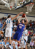 Washington's Chad Christensen (14) puts up a shot while being defended by Jefferson's Chad underwood (44) during the first half of their game at Jefferson High School in Cedar Rapids on Friday February 6, 2009. Washington led 33-14 at halftime.