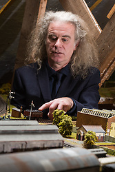 Brothers Simon, 53 and Paul Hurst, 58 have some of their late father's ashes carried around his extensive model railway in the loft of his home. PICTURED: Simon Hurst pushes his father's ashes in their coal wagon. The wagon is emblazoned with 'Blaenavon', a town in South Wales where their father was evacuated during the war. Leeds, Kent, March 15 2018.