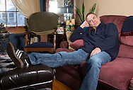 Nick Rhoades rests on his couch in the living room of his house in Waterloo, Iowa on Thursday, November 7, 2013.