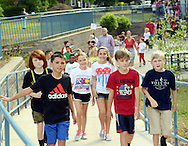Students participate in the annual Walk to Remember fundraiser for the Garden of Reflection during the Patriot Day celebration Friday September 9, 2016 at Lower Makefield Elementary School in Lower Makefield, Pennsylvania. (Photo by William Thomas Cain)