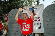 Flip Benham the leader of Operation Save America  holds his bible while  he protests outside theState capital in Jackson Mississippi Monday July 17,2006. Operation Save America is anti-abortion and plans to protest in jackson for as long as it takes to close the clinic, they are also planning protest at the state capital. Members of Operation Save America have come from all over hte United Staes to converge in Jackson Mississippi. (Photo©Suzi Altman)