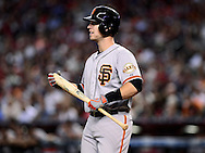Sep. 15, 2012; Phoenix, AZ, USA; San Francisco Giants catcher Buster Posey (28) reacts while at during the game against the Arizona Diamondbacks in the third inning at Chase Field. Mandatory Credit: Jennifer Stewart-US PRESSWIRE