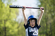 WAUPACA, WI-MAY 20, 2018: Ryder Vergauwen, 10, yells in excitement while holding a new USA Baseball approved bat after hitting a home run in home run derby at the end of practice. Players on the 10U Waupaca baseball team practice Sunday, May 20 at Swan Park in Waupaca, Wisc. USA Baseball has created a new standard for baseball bats that requires a specific barrel size, rendering most previously approved bats unacceptable for play. Lauren Justice for The New York Times