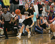 Jay Sarkis of Greece Athena dribbles down court during a game at Webster Schroeder High School on Friday, January 23, 2015.