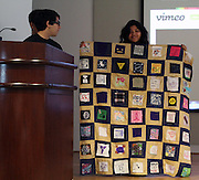 A student displays a quilt comprised of patches created by fellow students as part of their senior service project. The presentation was made at the Senior Summit on Tuesday, May 14, 2013.