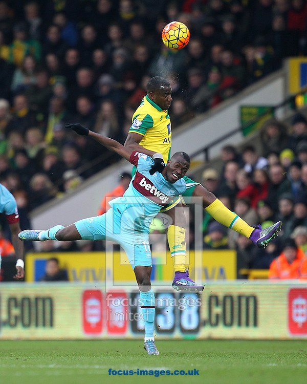 Sebastien Bassong of Norwich and Enner Valencia of West Ham in action during the Barclays Premier League match at Carrow Road, Norwich<br /> Picture by Paul Chesterton/Focus Images Ltd +44 7904 640267<br /> 13/02/2016