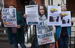 © Licensed to London News Pictures. 04/02/2016. London, UK. Supporters of Julian Assange stand near the Ecuadorian Embassy where the Wikileaks founder is living.  A United Nations panel is due to decide if Julian Assange has been kept in 'unlawful detention' during his stay at the embassy for the past three-and-a-half-years. Photo credit: Peter Macdiarmid/LNP