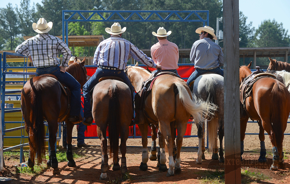 Photo by Gary Cosby Jr.      Cowboys wait outside the arena for their turn to compete during slack day at the Limestone Sheriff's Rodeo Thursday, May 17, 2012.