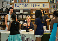 Huntington, New York, U.S. - August 6, 2014 - Huntington, New York, U.S. - August 6, 2014 - Hillary Rodham Clinton speaks with two young sisters at a book signing event promoting her new memoir, Hard Choices, at Book Revue in Huntington, Long Island, during a nationwide tour. Clinton's book is about her four years as America's 67th Secretary of State and how they influence her view of the future.