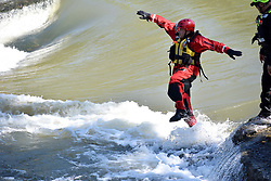 May 14, 2019 - Dayton, Ohio, U.S. - An Airman, assigned to the 178th Civil Engineering Squadron, jumps into swift water during swift water rescue training May 14, 2019 at Eastwood MetroPark in Dayton, Ohio. The 178th CES participated in a five day swift water rescue training course that taught them how to navigate tough currents, operate rescue boats, apply rope rescue techniques, rescue victims from the water and work together as a team. (Credit Image: ? U.S. National Guard/ZUMA Wire/ZUMAPRESS.com)