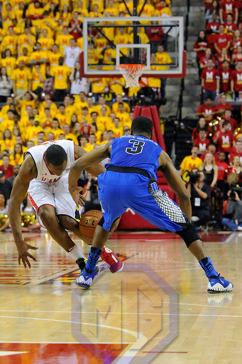 16 February 2013:   Maryland Terrapins guard/forward Dez Wells (32) turns the ball over to Duke Blue Devils guard Tyler Thornton (3) at the Comcast Center in College Park, MD. where the Maryland Terrapins upset the second ranked Duke Blue Devils, 83-81.