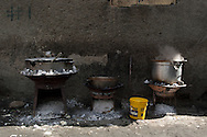 Food cooking in the streets of the community of Shada. Cap Haitian, Haiti, January 28, 2008.