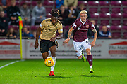Greg Leigh (#3) of Aberdeen FC and Callumn Morrison (#38) of Heart of Midlothian FC chase a ball during the Betfred Scottish Football League Cup quarter final match between Heart of Midlothian FC and Aberdeen FC at Tynecastle Stadium, Edinburgh, Scotland on 25 September 2019.