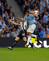 Manchester City's Gael Clichy battles for the high ball with Newcastle United's Mathieu Debuchy  - Photo mandatory by-line: Joe Meredith/JMP - Tel: Mobile: 07966 386802 19/08/2013 - SPORT - FOOTBALL - Etihad Stadium - Manchester - Manchester City V Newcastle United - Barclays Premier League