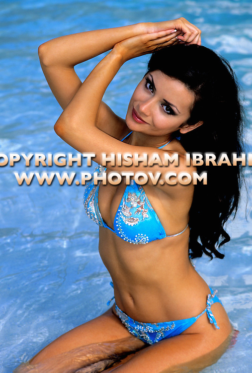 Sexy young Russian woman in blue bikini, Miami, Florida