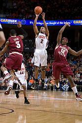 Virginia Cavaliers guard J.R. Reynolds (2) shoots over Florida State Seminoles forward Al Thornton (12) and Florida State Seminoles guard Isaiah Swann (3).  The Virginia Cavaliers Men's Basketball Team defeated the Florida State Seminoles 73-70 at the John Paul Jones Arena in Charlottesville, VA on February 17, 2007.