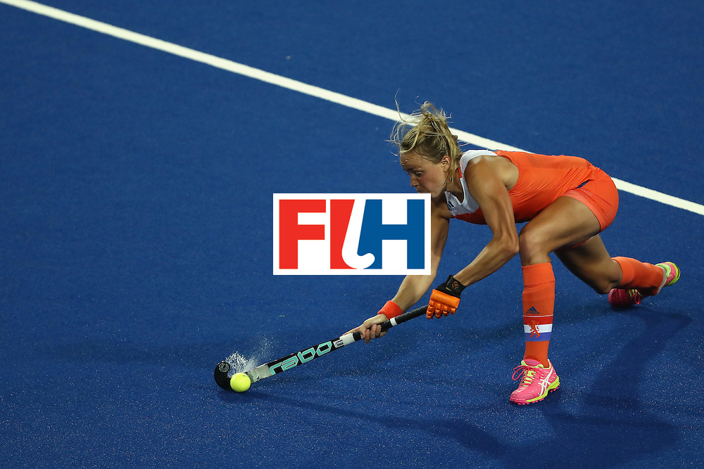 RIO DE JANEIRO, BRAZIL - AUGUST 08:  Maartje Paumen #17 of Netherlands passes the ball against Korea during a Women's Pool A match on Day 3 of the Rio 2016 Olympic Games at the Olympic Hockey Centre on August 8, 2016 in Rio de Janeiro, Brazil.  (Photo by Sean M. Haffey/Getty Images)