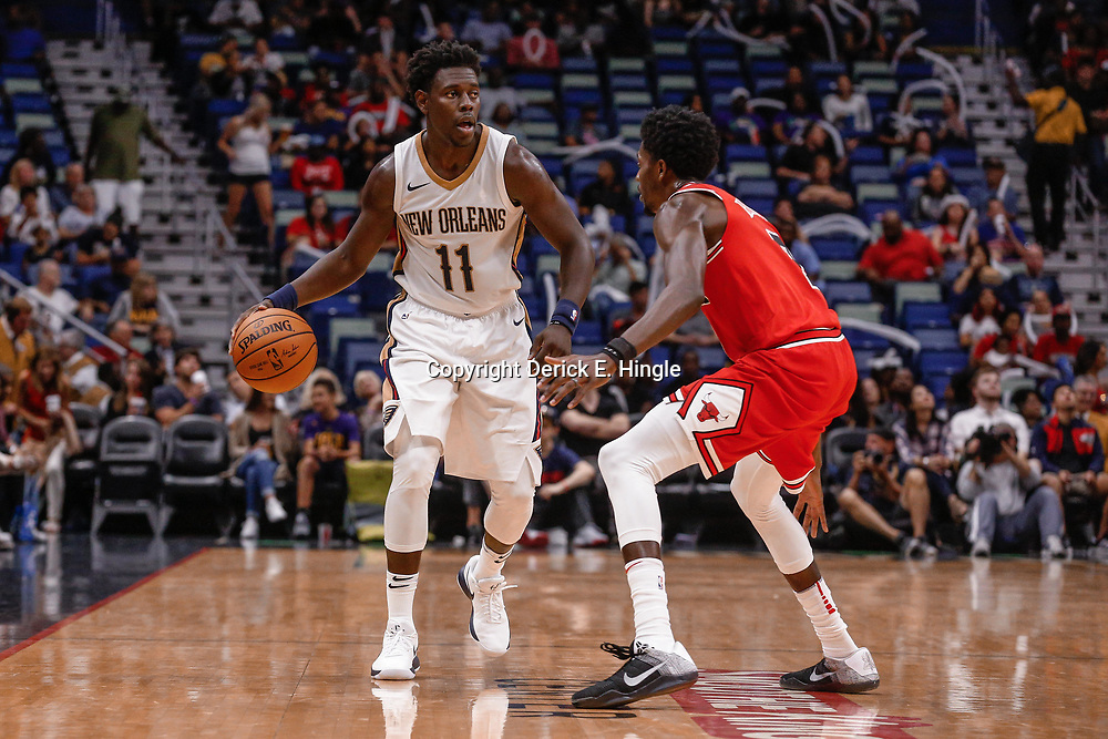 Oct 3, 2017; New Orleans, LA, USA; New Orleans Pelicans guard Jrue Holiday (11) is defended by Chicago Bulls guard Justin Holiday (7) during a NBA preseason game at the Smoothie King Center. The Bulls defeated the Pelicans 113-109. Mandatory Credit: Derick E. Hingle-USA TODAY Sports