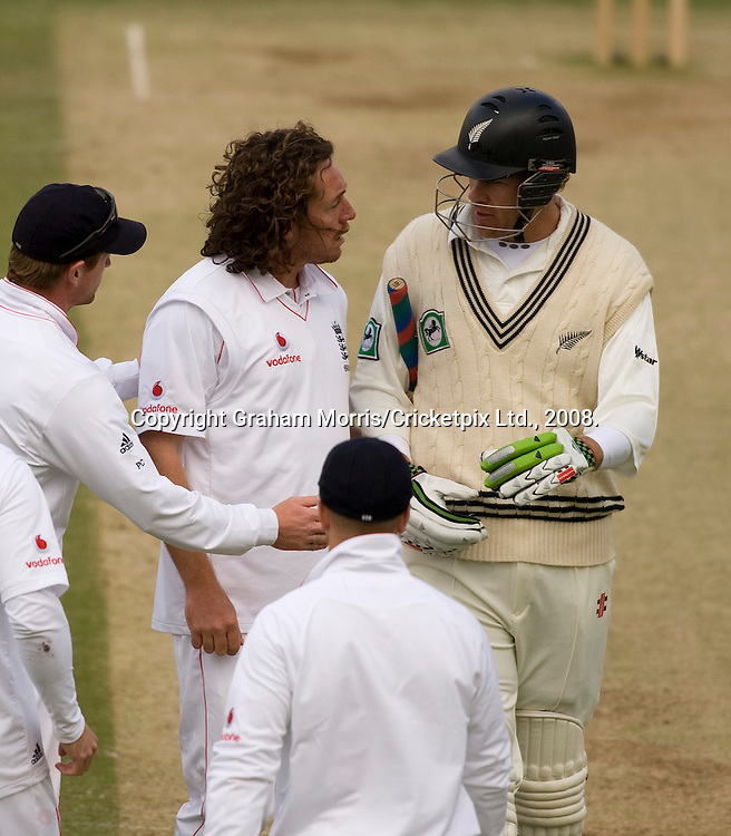 After bowling him Ryan Sidebottom congratulates (?) Jacob Oram on his century in the first npower Test Match between England and New Zealand at Lord's. Photograph © Graham Morris/cricketpix.com (Tel: +44 (0)20 8969 4192; Email: sales@cricketpix.com)