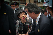 Tokyo - August 23th 2009 -  A japanese lady shakes hands of Yukio Hatoyama, president of Democratic Party of Japan (DPJ) and favorite for the seat of Prime Minister, during the campaign in the Yanaka area.