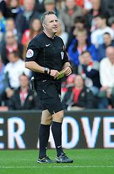 Referee, Jonathan Moss - Photo mandatory by-line: Dougie Allward/JMP - Mobile: 07966 386802 - 25/10/2014 - SPORT - Football - Southampton - ST Mary's Stadium - Southampton v Stoke - Barclays Premier League