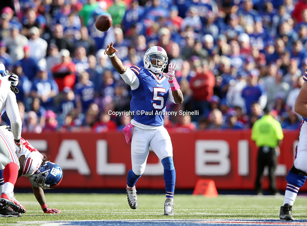 Buffalo Bills quarterback Tyrod Taylor (5) throws a pass during the 2015 NFL week 4 regular season football game against the New York Giants on Sunday, Oct. 4, 2015 in Orchard Park, N.Y. The Giants won the game 24-10. (©Paul Anthony Spinelli)
