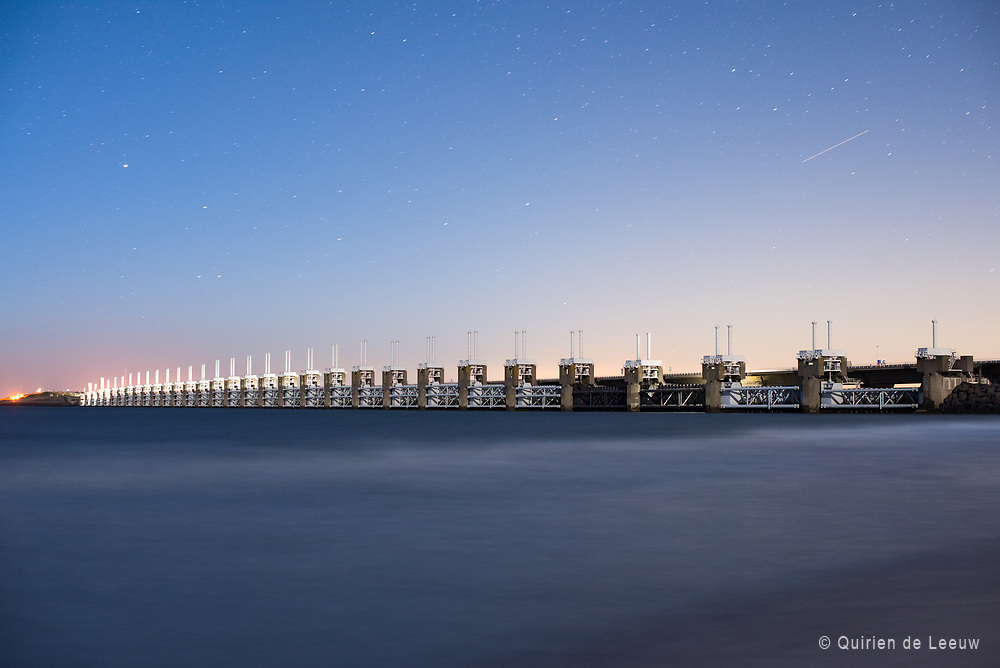 "The Oosterscheldekering DeltaWorks protection barrier at night, Zeeland province. ""One of the Seven Wonders of the Modern World""."