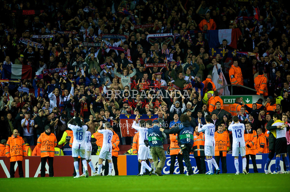 LIVERPOOL, ENGLAND - Tuesday, October 20, 2009: Olympique Lyonnais's players celebrate with their fans after their 2-1 victory over Liverpool during the UEFA Champions League Group E match at Anfield. (Pic by David Rawcliffe/Propaganda)