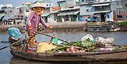 Vegetable seller on floating market on Mekong Delta (Vietnam)