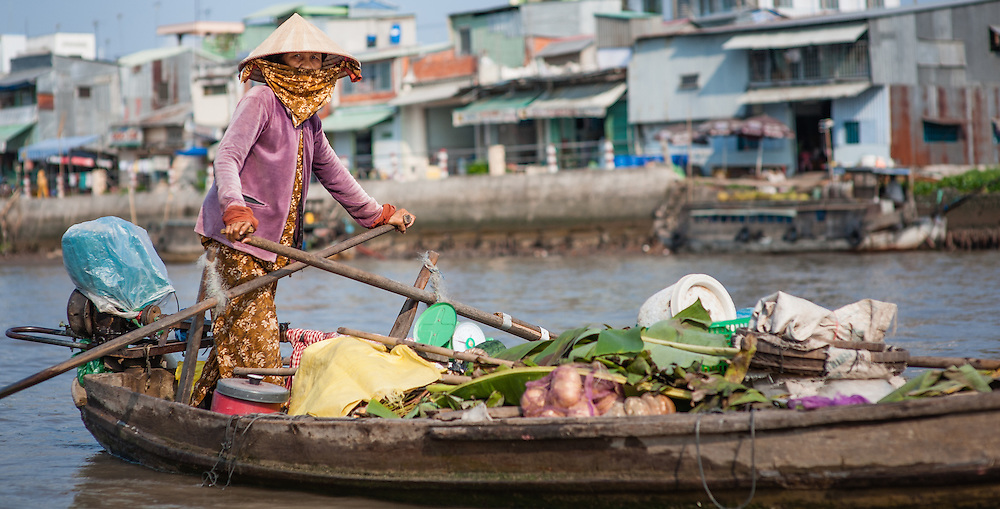 Vegetable seller on floating market on Mekong Delta (Vietnam)