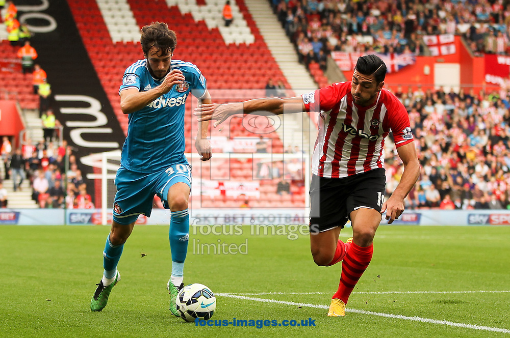 Graziano Pell&egrave; (right) of Southampton and Will Buckley (left) of Sunderland battle for the ball during the Barclays Premier League match at the St Mary's Stadium, Southampton<br /> Picture by Tom Smith/Focus Images Ltd 07545141164<br /> 18/10/2014