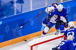 GANGNEUNG, SOUTH KOREA - FEBRUARY 20: defenseman Blaz Gregorc #15 of Slovenia, forward Alexander Reichenberg #61 of Norway in action during Ice - Hockey match between National Teams of Slovenia and Norway in the Men's Play-offs Qualifications on day eleven of the PyeongChang 2018 Winter Olympic Games at Gangneung Hockey Centre on February 20, 2018 in Gangneung, South Korea.  Photo by Ronald Hoogendoorn / Sportida