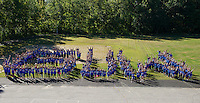 300 strong - Pleasant Street School students, faculty and volunteers spell out G U V for Granite United Way as they begin their morning going to several locations throughout Laconia for the United Way Day of Caring Friday.  (Karen Bobotas/for the Laconia Daily Sun)