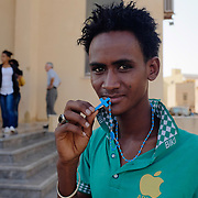 A young Eritrean refugee outside the church in Lampedusa