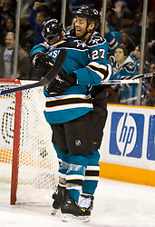 January 23, 2010; San Jose, CA, USA; San Jose Sharks center Joe Pavelski (8) is congratulated by center Manny Malhotra (27) after scoring a goal against the Buffalo Sabres during the second period at HP Pavilion. San Jose defeated Buffalo 5-2. Mandatory Credit: Jason O. Watson / US PRESSWIRE
