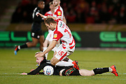 Barnsley defender Ben Williams (28) is fouled by Herbie Kane of Doncaster Rovers  during the EFL Sky Bet League 1 match between Doncaster Rovers and Barnsley at the Keepmoat Stadium, Doncaster, England on 15 March 2019.