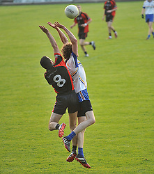 Hollymount Carramore's Padraig Feerick and Swinford's Stephen Henry contest a kick out during the quarter final clash at McHale Park on saturday evening.<br /> Pic Conor McKeown