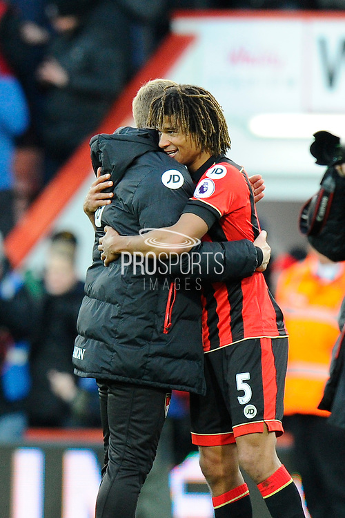AFC Bournemouth manager Eddie Howe hugs the winning goal scorer Nathan Ake of AFC Bournemouth at full time to celebrate the 4-3 win over Liverpool during the Premier League match between Bournemouth and Liverpool at the Vitality Stadium, Bournemouth, England on 4 December 2016. Photo by Graham Hunt.