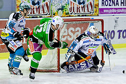 John Hughes (HDD Tilia Olimpija, #72) vs Alex Westlund (EHC Liwest Linz, #32) during ice-hockey match between HDD Tilia Olimpija and EHC Liwest Black Wings Linz in 51st Round of EBEL league, on Februar 5, 2012 at Hala Tivoli, Ljubljana, Slovenia. (Photo By Matic Klansek Velej / Sportida)
