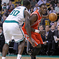 06 March 2012: Houston Rockets center Samuel Dalembert (21) drives past Boston Celtics power forward Brandon Bass (30) during the Boston Celtics 97-92 (OT) victory over the Houston Rockets at the TD Garden, Boston, Massachusetts, USA.