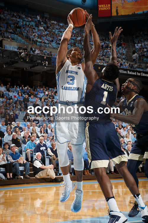CHAPEL HILL, NC - JANUARY 31: Kennedy Meeks #3 of the North Carolina Tar Heels shoots over Jamel Artis #1 of the Pittsburgh Panthers on January 31, 2017 at the Dean Smith Center in Chapel Hill, North Carolina. North Carolina won 80-78. (Photo by Peyton Williams/UNC/Getty Images) *** Local Caption *** Kennedy Meeks;Jamel Artis