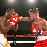 Conor Coyle lands a solid right hand as he fights Joshua Maxwell during a Fire Fist Boxing Promotions boxing match at the A La Carte Pavilion on Saturday, August 12 , 2017 in Tampa, Florida.  (Alex Menendez via AP)