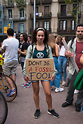 Don't be a fossil fool! Climate Strike, Fridays for the Future, September 28, 2019. 20,000 people took to the streets, joining more than 7 million worldwide calling for climate action.  At <br /> Jardins de Salvador Espriu<br /> , Gracia, and Diagonal, Barcelona