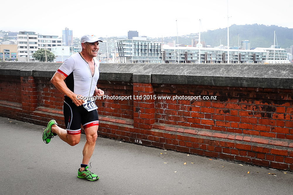 A competitor head out on the run leg of the Sovereign Tri Series, Waterfront, Wellington, New Zealand. Saturday 14 March 2015. Copyright Photo: Mark Tantrum/www.Photosport.co.nz