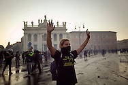 ITALY, Rome, October 15, 2011: A demonstrator put his hands up in front of the St. John in Lateran basilica during clashes in Rome, Saturday, Oct. 15, 2011.  © Christian Minelli/Emblema.
