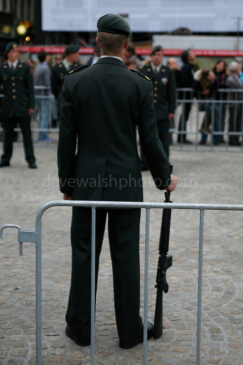 Soldier with gun, part of a guard of honour at Dam Square, WW2 Remembrance Day Ceremony in Amsterdam May 4th 2009. The Dutch Queen Beatrix attended, under heavy security and sniper cover following an attempted attack on the Royal Family on Queens Day in Apeldoorn