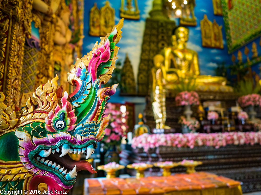 30 JANUARY 2016 - NONTHABURI, NONTHABURI, THAILAND: A naga, or mythical serpent, in front of the Buddha at Wat Bua Khwan, a large Buddhist temple in Nonthaburi, north of Bangkok, Thailand.        PHOTO BY JACK KURTZ