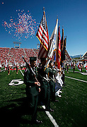 A military honor guard carry the colors as balloons a released into the air during a ceremony to remember the terrorist attack on September 11, 2001 before Utah's game against UNLV at Rice-Eccles Stadium, Saturday, Sept. 11, 2010, in Salt Lake City, Utah.  (AP Photo/Colin E. Braley)